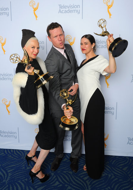 "Lou Eyrich, from left, Ken van Duyne and Elizabeth Macey, winners of the award for outstanding costumes for a period drama/ fantasy series, limited series, or movie for ""American Horror Story: Freak Show"", pose for a portrait at the Television Academy's Creative Arts Emmy Awards at Microsoft Theater on Saturday, September 12, 2015, in Los Angeles. (Photo by Vince Bucci/Invision for the Television Academy/AP Images)"