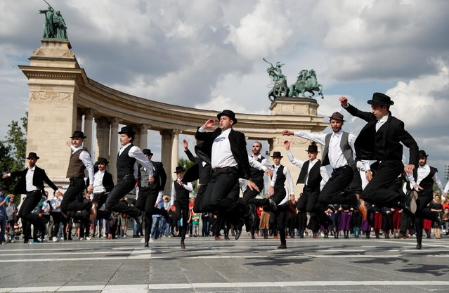 Dancers perform during the 100th anniversary of the Treaty of Trianon at Heroes' Square in Budapest, Hungary, June 4, 2020. (Photo by Bernadett Szabo/Reuters)