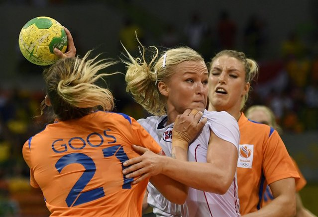 Stine Bredal Oftedal (C) of Norway in action with Michelle Goos (L) and Nycke Groot (R) of Netherlands during women's bronze medal match between Netherlands and Norway of the Rio 2016 Olympic Games at the Future Arena in the Olympic Park in Rio de Janeiro, Brazil, 20 August 2016. (Photo by Marijan Murat/EPA)
