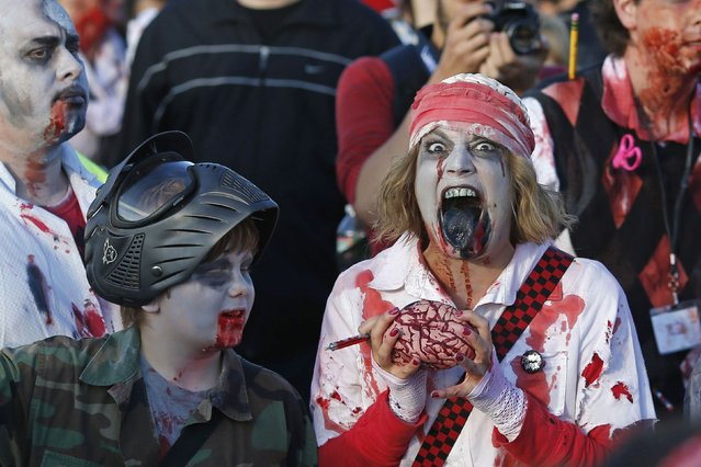 Revellers take part in a Zombie Walk in Asbury Park, New Jersey October 4, 2014. (Photo by Eduardo Munoz/Reuters)