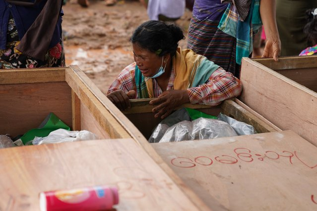 A woman grieves over a body of a miner during a funeral ceremony near Hpakant in Kachin state on July 3, 2020. Rescuers on July 3 pulled several bodies from the scene of a landslide which killed over 160 jade miners in northern Myanmar, many of them migrant workers seeking their fortune in treacherous open-cast mines near the China border. (Photo by Zaw Moe Htet/AFP Photo)