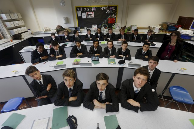 Year 9 Biology boys class pose for a picture with teacher Suzanne Veitch in their classroom at Forest School, London, April 27, 2015. (Photo by Russell Boyce/Reuters)