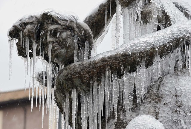 The fountain of Piazza della Repubblica is frozen on December 17, 2010 in Rome. (Photo by Andreas Solaro/AFP Photo)