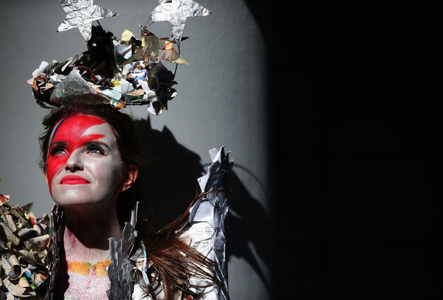 "The 2016 Junk Kouture Eastern winner Rebecca McNally wears ""A Tribute to Ziggy Stardust"" during the Bank of Ireland Junk Kouture 2017 contest launch at Charlotte Quay in Dublin on September 8, 2016. The contest is Ireland's recycled fashion competition for secondary school students which invites young people to design and create works of fashion art from recyclable materials. (Photo by Brian Lawless/PA Wire)"