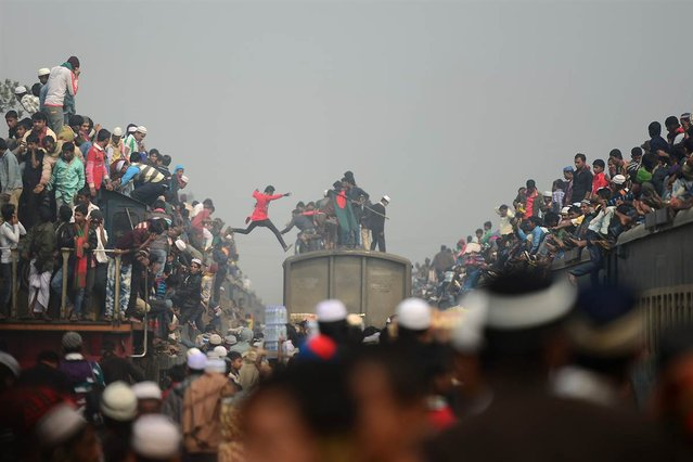 Muslim devotees arrive on overcrowded trains to attend the Biswa Ijtema, or World Muslim Congregation, at Tongi, Bangladesh, on January 13, 2013. At least 3 million Muslims joined in prayer on the banks of a river in Bangladesh as the world's second-largest annual Islamic congregation ended. (Photo by Munir Uz Zaman/AFP Photo)