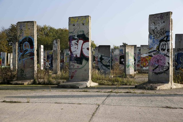 Segments of the Berlin Wall, which are for sale, are seen at a storage yard in Teltow, south of Berlin October 29, 2014. (Photo by Fabrizio Bensch/Reuters)