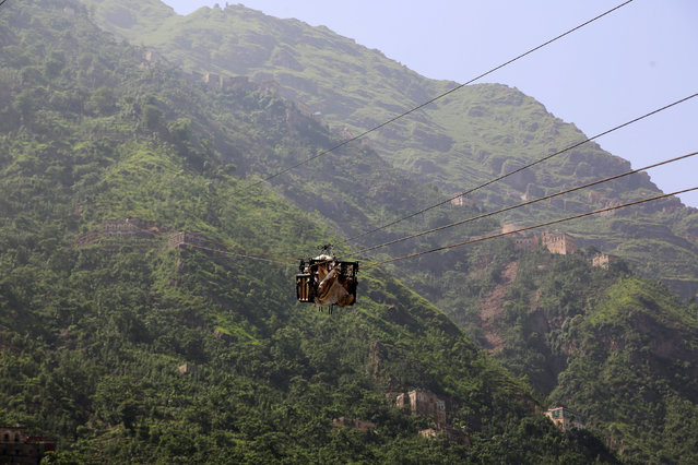 A cable car carries supplies to Dhalamlam Mountain, in the Jafariya district of the western province of Raymah, Yemen May 20, 2016. (Photo by Abduljabbar Zeyad/Reuters)