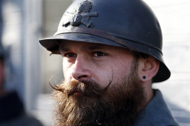 """A history enthusiast member of French association """"Le Poilu de la Marne"""" attends an Armistice Day ceremony to commemorate the end of World War One at Epernay, eastern France, November 11, 2014. (Photo by Charles Platiau/Reuters)"""
