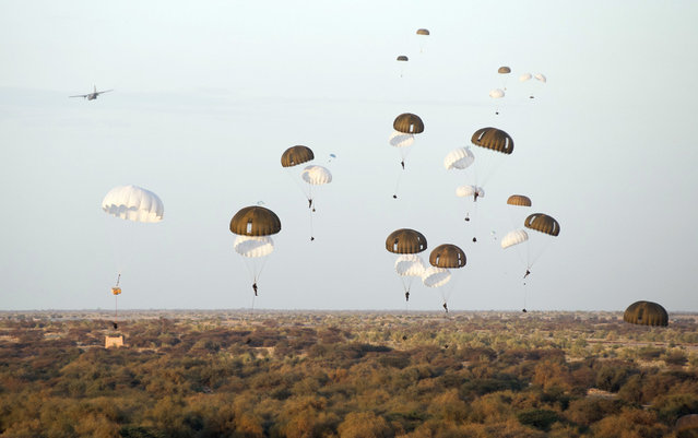 French paratroopers drop from a plane over Timbuktu airport in Mali, on January 29, 2013. (Photo by Olivier Debes/AP Photo/ECPAD/The Atlantic)