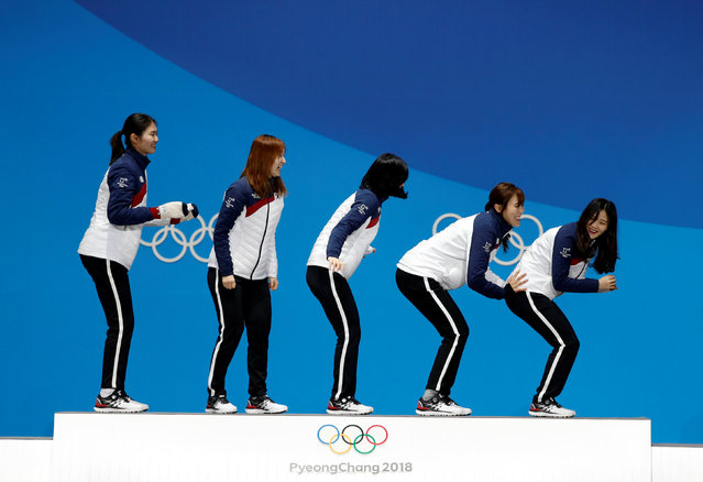 South Korea' s gold medallists Shim Sukhee, Choi Minjeong, Kim Yejin, Kim Alang and Lee Yubin pose on the podium during the medal ceremony for the short track Women' s 3000 m relay at the Pyeongchang Medals Plaza during the Pyeongchang 2018 Winter Olympic Games in Pyeongchang on February 21, 2018. (Photo by Kim Hong-Ji/Reuters)