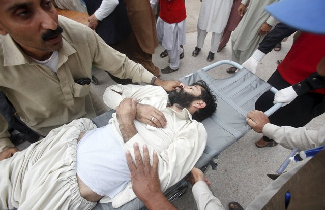 Rescue workers move a man, who was injured during an earthquake, at the Lady Reading hospital in Peshawar, Pakistan, October 26, 2015. A powerful earthquake struck a remote area of northeastern Afghanistan on Monday, shaking the capital Kabul, as shockwaves were felt in northern India and in Pakistan's capital, where hundreds of people ran out of buildings as the ground rolled beneath them. (Photo by Fayaz Aziz/Reuters)