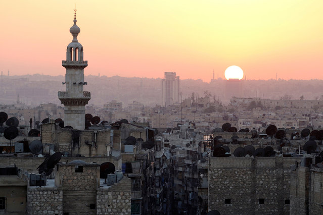 The sun sets over Aleppo as seen from rebel-held part of the city, Syria October 5, 2016. (Photo by Abdalrhman Ismail/Reuters)