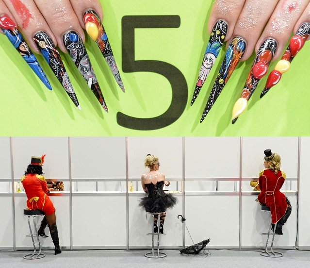 """Models show their nails to  jury members, behind a wall, during the 6th German Nailart-Trophy """"Circus, Magic – Manege""""  at the BEAUTY FORUM and trade fair in Leipzig, on April 13, 2013. The event is one of the most important cosmetic trade fairs in Germany. (Photo by Jens Meyer/Associated Press)"""