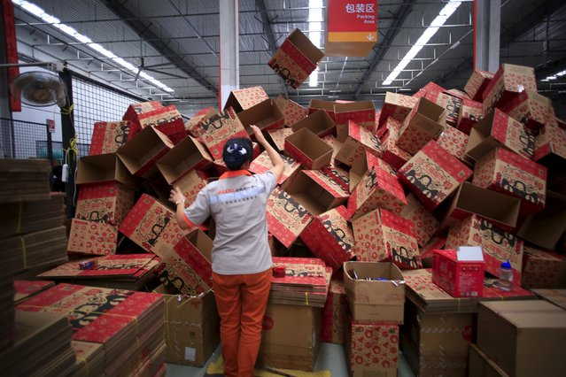 An employee works at a Tmall logistic centre in Suzhou, Jiangsu province, China, October 28, 2015. (Photo by Jason Lee/Reuters)