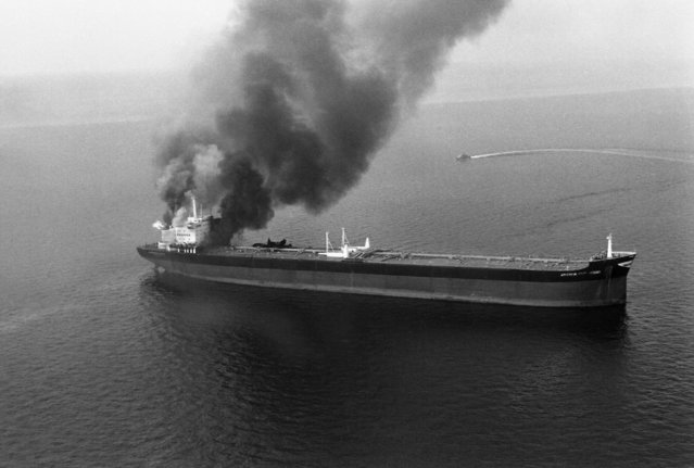 "The Taiwan-registered oil tanker ""Energy Determination"", seen ablaze and sinking off Coin Island in the Hormuz Straits on Thursday, December 13, 1979. The cause of the fire was not known. The 320,000 ton tanker was empty and heading north when fire broke out around 0100 local time. Oman patrol boats responded to a distress call from the ship and rescued 37 crew members but one was still unaccounted for. (Photo by AP Photo)"