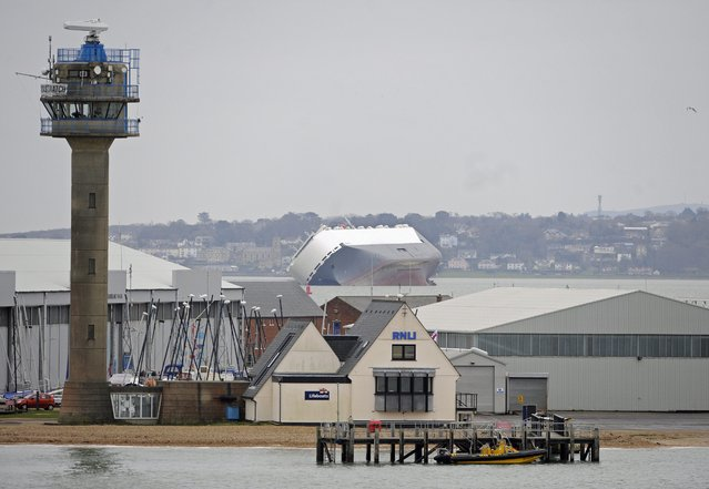 "The stricken vessel ""Hoegh Osaka"" lies trapped on her side on the Brambles Sand Bank between Calshot Bay and Cowes on The Isle of Wight, Britain, 05 January 2015. (Photo by Gerry Penny/EPA)"