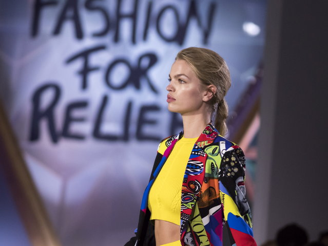 Daphne Groeneveld walks the runway at Fashion For Relief show during the 71st annual Cannes Film Festival at Aeroport Cannes Mandelieu in Cannes, France, 13 May 2018. (Photo by Arnold Jerocki/EPA/EFE)