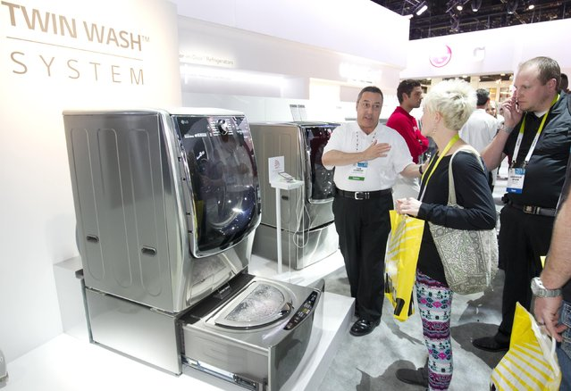 Tom Dowens explains the benefits of the LG Electronics Twin Wash System washing machine during the 2015 International Consumer Electronics Show (CES) in Las Vegas, Nevada January 6, 2015. The washer has a second, smaller washer built into the bottom of the machine for doing two different loads at once. (Photo by Steve Marcus/Reuters)