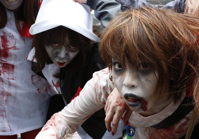 People, dressed as zombies, participate in the Roppongi Zombie Walk in Tokyo March 31, 2013. (Photo by Yuya Shino/Reuters)