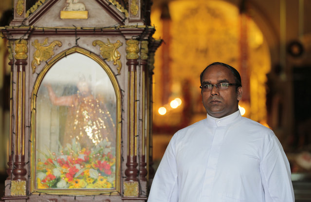 In this Wednesday, January 7, 2015 photo, Sri Lankan Catholic reverend Fr. Heshan Fernando poses for a photograph at a church in Colombo, Sri Lanka. Fernando said the Catholics in Sri Lanka are a people who have been taught to be happy in serving the lord and that there is joy in their lives. (Photo by Eranga Jayawardena/AP Photo)
