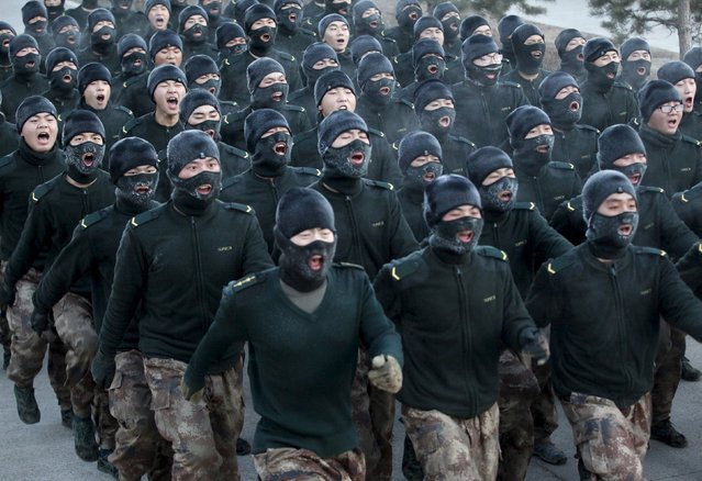 New recruit People's Liberation Army (PLA) soldiers shout slogans as they march during a training session in cold winter temperatures at a military base in Heihe, Heilongjiang province, China, November 29, 2015. (Photo by Reuters/China Daily)