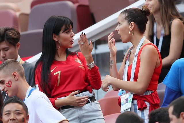 Georgina Rodriguez (L), Cristiano Ronaldo's girlfriend, reacts during the FIFA World Cup 2018 group B preliminary round soccer match between Portugal and Morocco in Moscow, Russia, 20 June 2018. (Photo by BackGrid)
