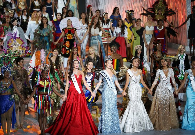 Miss Spain, Mireia Lalaguna Royo (C) performs with other contestants after winning the Miss World title during the grand final of the 65th Miss World pageant at the Beauty Crown Hotel Complex in Sanya, Hainan province, China, 19 December 2015. (Photo by How Hwee Young/EPA)