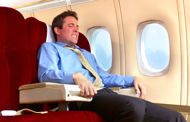 Man with fear of flying. (Photo by Peter Dazeley/Getty Images)