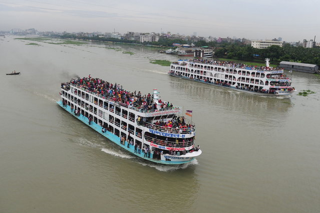 Bangladeshis ride packed ferries as they rush home to be with their families in their respective villages ahead of the Eid al-Fitr festival at the Sadarghat ferry terminal on the outskirts of Dhaka on August 7, 2013. The Eid al-Fitr, the biggest festive Muslim event, marks the end of the holy fasting month of Ramadan. (Photo by Munir uz Zaman/AFP Photo)