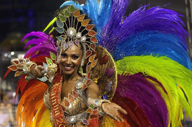 A member of samba school Imperio de Casa Verde takes part in a carnival parade at Anhembi Sambodrome during second day of Brazilian carnival in Sao Paulo, Brazil, early morning 15 February 2015. (Photo by Bosco Martin/EPA)