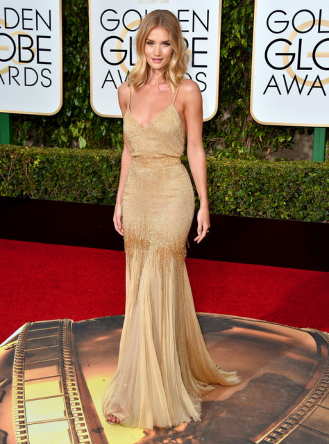 Rosie Huntington-Whiteley arrives at the 73rd annual Golden Globe Awards on Sunday, January 10, 2016, at the Beverly Hilton Hotel in Beverly Hills, Calif. (Photo by Jordan Strauss/Invision/AP Photo)