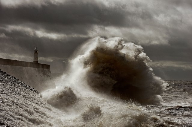 High waves batter the sea wall at Porthcawl South Wales as Storm Francis hits the South Wales Coast on August 25, 2020. (Photo by London News Pictures)