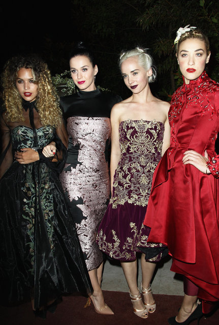 """(L-R) Guest, Katy Perry, Mia Morreti and Caitlin Moe attend the """"Mademoiselle C"""" cocktail party at Pavillon Ledoyen on October 1, 2013 in Paris, France. (Photo by Julien M. Hekimian/Getty Images)"""