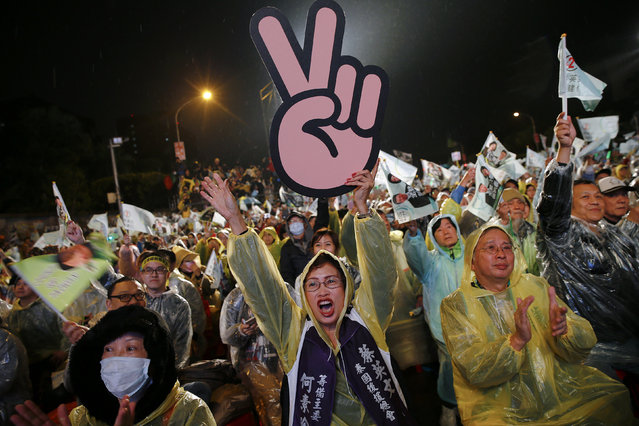 Supporters of Taiwan's Democratic Progressive Party (DPP) react as the chairperson and presidential candidate Tsai Ing-wen addresses the crowd during a final campaign rally ahead of the elections in Taipei, Taiwan, January 15, 2016. (Photo by Damir Sagolj/Reuters)
