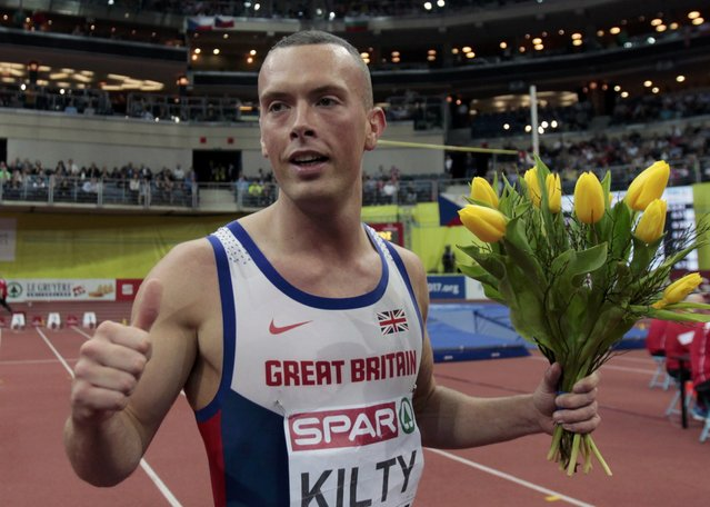 Richard Kilty of Britain celebrates after winning the men's 60 metres final during the European Indoor Championships in Prague March 8, 2015. REUTERS/David W Cerny (CZECH REPUBLIC  - Tags: SPORT ATHLETICS)