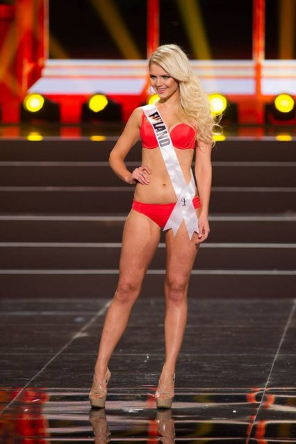 This photo provided by the Miss Universe Organization shows Lotta Hintsa, Miss Finland 2013, competes in the swimsuit competition during the Preliminary Competition at Crocus City Hall, Moscow, on November 5, 2013. (Photo by Darren Decker/AFP Photo)