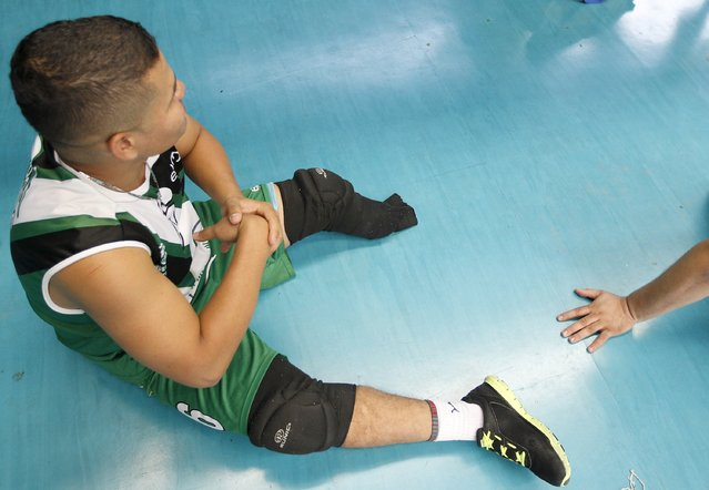A National Army of Colombia soldier, who was wounded by a mine, prepares to play sitting volleyball in Bello, municipality of Antioquia, March 25, 2015. (Photo by Fredy Builes/Reuters)