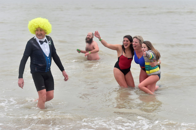 Revellers take part in a New Year's dive in Ostend on the North Sea coast in Belgium January 1, 2017. (Photo by Eric Vidal/Reuters)