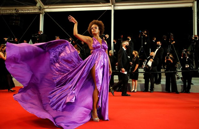 """A guest arrives for the screening of the film """"Les Olympiades"""" (Paris 13th District) at the 74th edition of the Cannes Film Festival in Cannes, southern France, on July 14, 2021. (Photo by Sarah Meyssonnier/Reuters)"""