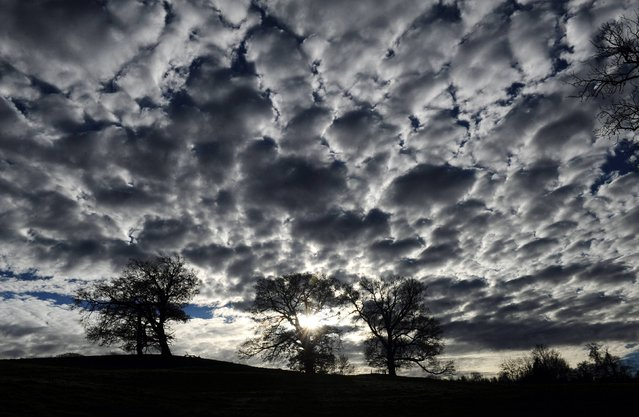 Clouds gather on the horizon over Fountains Abbey, Ripon, North Yorkshire, on November 27, 2013. (Photo by Anna Gowthorpe/PA Wire)