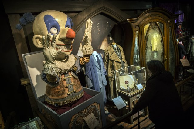 A visitor looks at movie props, including a jack-in-the-box (L), during the press opening of the Harry Potter exhibition at the Cite du Cinema in Paris, France, 02 April 2015. The exhibition runs from 04 April to 06 September. (Photo by Etienne Laurent/EPA)