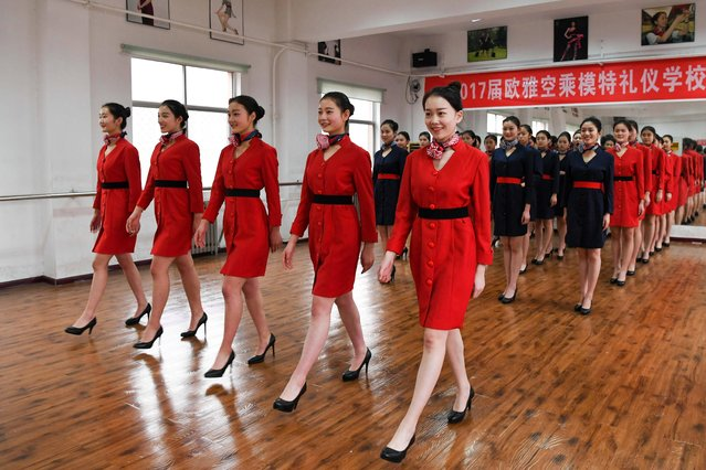 Students attend a stewardess skill training for the upcoming 2017 entrance examination for art majors in colleges in Luoyang, central China's Henan Province, January 4, 2017. The proper stewardess strut is another of the skills the students must master in the class. (Photo by Li Bo/Xinhua/Barcroft Images)
