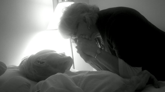 """""""I know he will watch over me from above"""". This picture is of my mother embracing my granddaddy's hands one last time before we left his bedside before his passing. They had an amazing bond and I know he was squeezing her hand and telling her it was going to be ok even if he wasn't able to speak the words. Photo location: Norfolk, VA. (Photo and caption by Sara Albin/National Geographic Photo Contest)"""