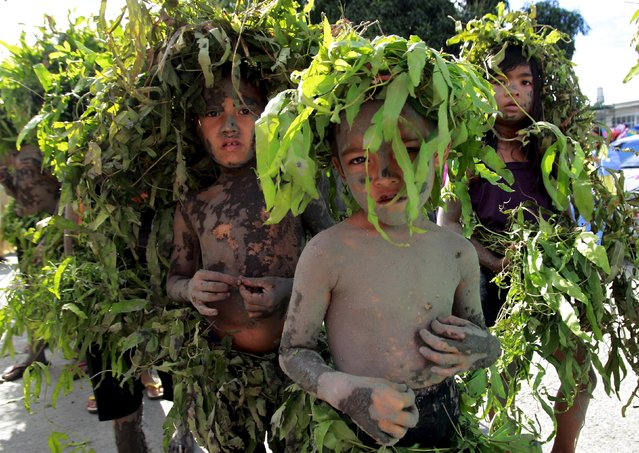 Children covered with mud and leaves parade along the streets of Boac town on Marinduque island in central Philippines, April 1, 2015, as part of their devotion to their faith, an annual occurrence during Holy Week. (Photo by Romeo Ranoco/Reuters)