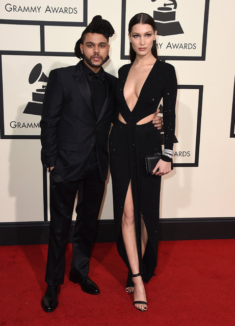 The Weeknd, left, and Bella Hadid arrive at the 58th annual Grammy Awards at the Staples Center on Monday, February 15, 2016, in Los Angeles. (Photo by Jordan Strauss/Invision/AP Photo)