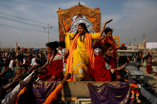 """Members of the """"Kinnar Akhada"""" congregation for transgender people give blessings to devotees during the first """"Shahi Snan"""" (grand bath) at """"Kumbh Mela"""" or the Pitcher Festival, in Prayagraj, previously known as Allahabad, India, January 15, 2019. (Photo by Danish Siddiqui/Reuters)"""