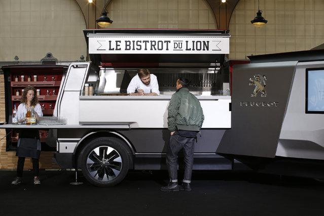 The Peugeot food truck, named Le Bistrot du Lion, is seen during a press presentation in Paris April 2, 2015. (Photo by Benoit Tessier/Reuters)