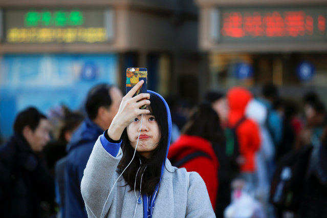 A passenger takes picture of herself at the Beijing Railway Station in central Beijing, China January 13, 2017 as the annual Spring Festival travel rush begins ahead of the Chinese Lunar New Year. (Photo by Damir Sagolj/Reuters)