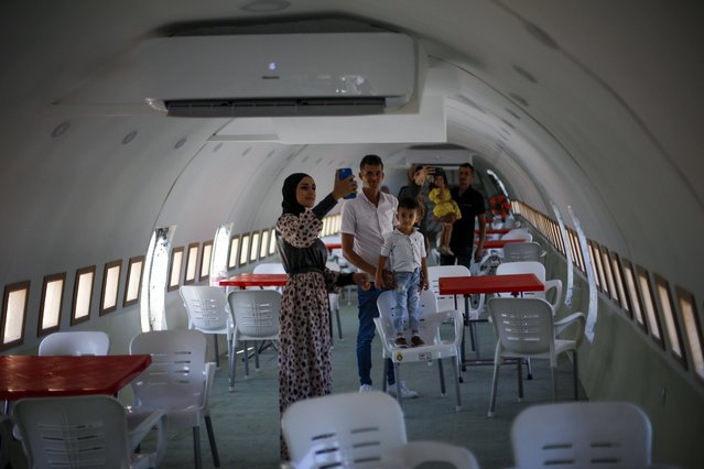Palestinians visit the interior of a Boeing 707 after it was converted to a cafe restaurant, in Wadi Al-Badhan, near the West Bank city of Nablus, Wednesday, August 11, 2021 (Photo by Majdi Mohammed/AP Photo)