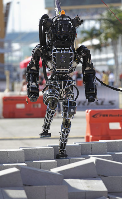 Boston Dynamics' Atlas, a high-mobility, humanoid robot designed to negotiate rough terrain, takes on an irregular surface in this terrain negotiation exercise in Homestead, Florida December 20, 2013